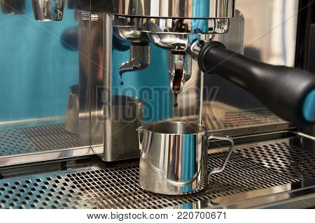 Preparation of invigorating drink. Coffee machine. Espresso