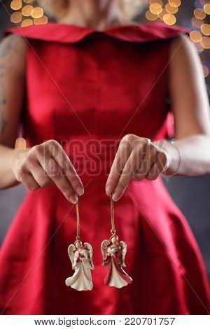 Girl holds Christmas angels. Christmas concept idea