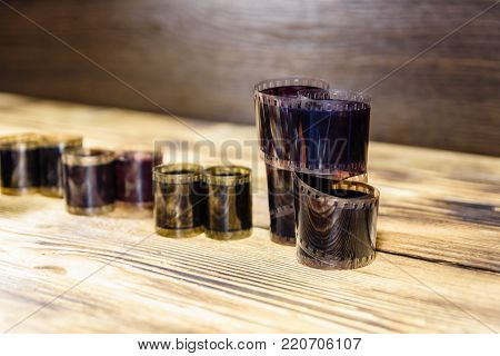 Old obsolete films on rustic wooden table