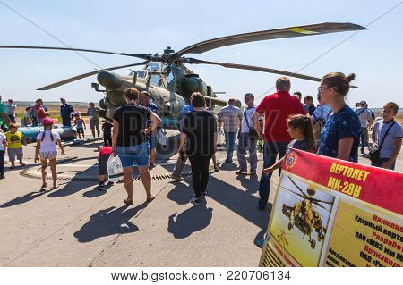 KADAMOVSKIY TRAINING GROUND, ROSTOV REGION, RUSSIA, 26 AUGUST 2017: International military technical forum «ARMY-2017». Attack helicopter «Mi-28N» «Night Hunter» and the show visitors