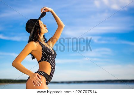 portrait of happy slim beautiful woman in bikini posing on the beach