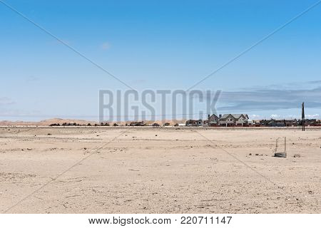 Settlement in front of the dunes of the Namib Desert on the eastern outskirts of Swakopmund