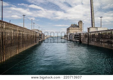 Sault Ste Marie, Michigan, USA - August 9, 2015: Water level view through the world famous International Soo Locks in Michigan. The locks allow freighters up to 1000 feet to navigate from Lake Superior to the St Marys River.