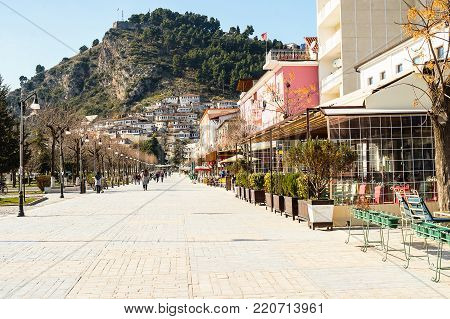 View to Berat, historic city in the south of Albania, during a sunny day. Tiny stone streets and white houses built on a high hill one over another.