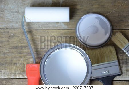 White paint, paint brush, roller for paint, repair concept. for painted surface with a waterproof paint by cushion and brush