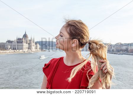 Young woman pulling hair with closed eyes at Budapest, Hungary