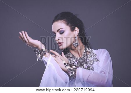 Sexy oriental belly dancer performance portrait in cinematic style