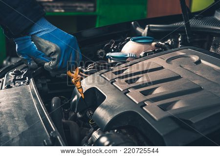 Maintaining Car Oil Check. Engine Oil Check Closeup Photo.