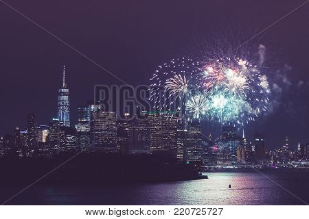 New York City Celebration with Fireworks. Manhattan Skyline with Blowing Fireworks. United States of America.