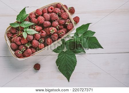 Collected raspberries in a basket. Top view.