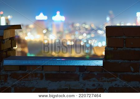 Defocused Night Cityscape From A Rooftop