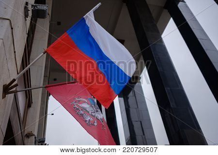National flag of Russian Federation and Moscow on the house background