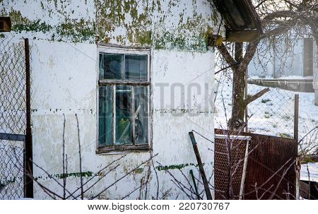 old house with irritated paint in a dead place