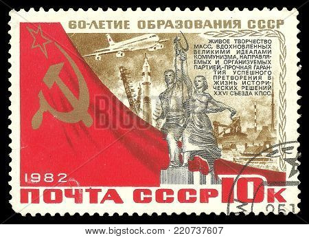 USSR - circa 1982: Stamp printed by USSR, Color edition on 60th Anniversary formation of state, shows Monument worker and peasant woman, circa 1982