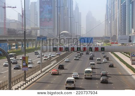 Dubai, Uae - November 22, 2017: Traffic And Air Pollution Haze In Dubai, United Arab Emirates. Dubai