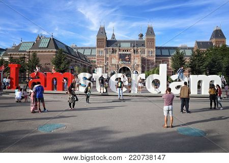 Amsterdam, Netherlands - July 9, 2017: People Visit Rijks Museum In Amsterdam. Amsterdam Is The Capi