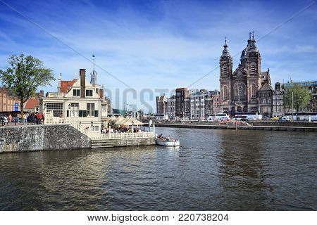 Amsterdam, Netherlands - July 9, 2017: People Visit Open Havenfront Canal In Amsterdam, Netherlands.