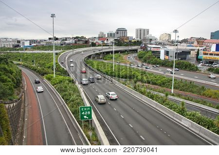 Auckland, New Zealand - March 13, 2008: People Drive On Freeway Interchange In Suburbs Of Auckland,