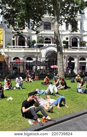 LONDON, UK - JULY 7, 2016: People visit Leicester Square in London, UK. London is the most populous city in the UK with 13 million people living in its metro area.