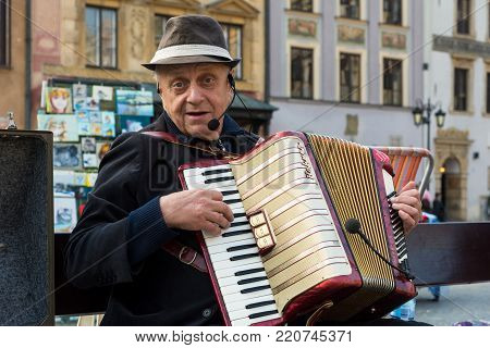 WARSAW, POLAND - OCTOBER 20, 2017: A man plays his accordion in the old town of Warsaw, Poland on October 20, 2017