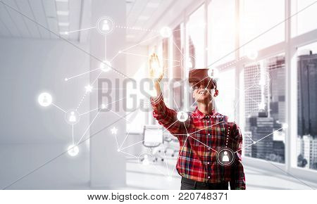 Young man with virtual reality headset or 3d glasses over social connection background . Mixed media