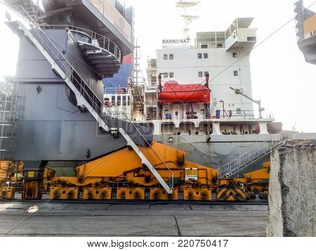 Novorossiysk, Russia - August 11, 2016: Self-propelled port crane. Mobile platform for moving the lifting mechanism.