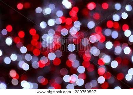 Bright unfocused color lights in the dark, holiday background