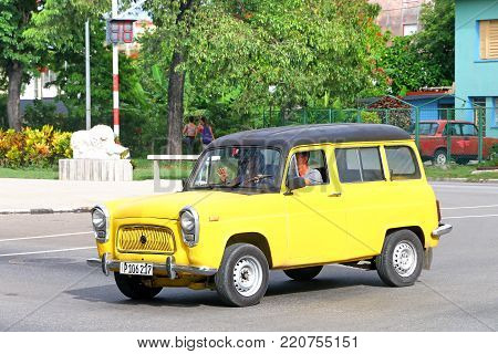 Havana, Cuba - June 6, 2017: Yellow estate car Ford Squire in the city street.