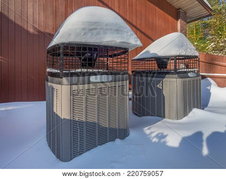 Heating and air conditioning units used to heat a house in winter