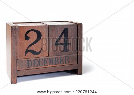 Wooden Perpetual Calendar set to December 24th, Christmas Eve