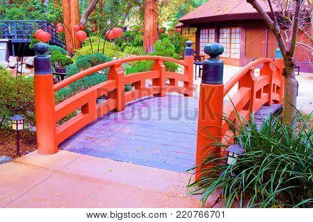 January 1, 2018 in La Canada, CA:  Japanese Orange Bridge taken at the Japanese Garden within the Descanso Gardens in La Canada, CA where people can visit and see an authentic Japanese Garden with flora native to Japan and Japanese architectural design
