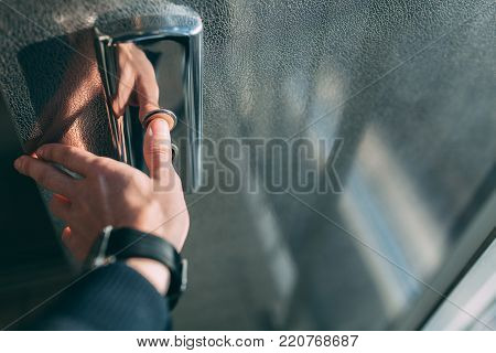 The thumb presses the Elevator button, a hand reaching for the button, the girl waiting for Elevator, push button start, isolated