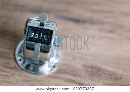 Concept Of Happy New Year 2018 Celebration. Number Hand Tally Counter Stop At 2018 On White Wooden T