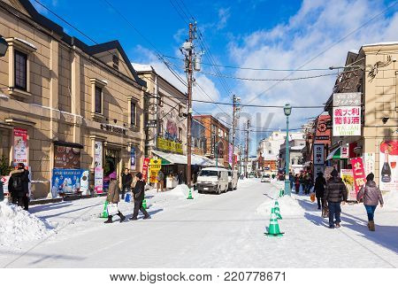 Otaru, Hokkaido, Japan - 30 December 2017, Famous Otaru city fills with tourists and visitors around the world on bright sunny and cold winter day of December 30, 2017 in Otaru, Hokkaido, Japan