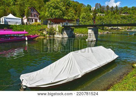 Rhein waterfall, Germany - April 2017: boats in the Rheinfall basin on a sunny day