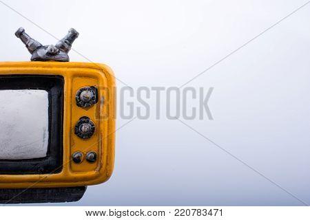 Retro syled tiny television model on a white background