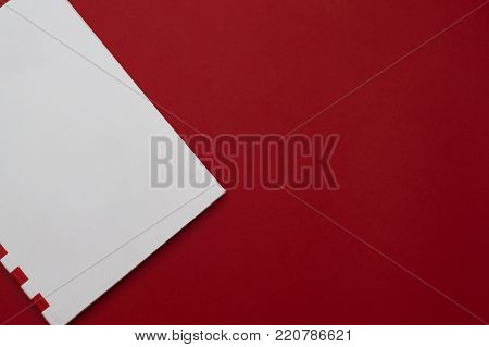 Front view of the white with red stripes memo pad part on the red background