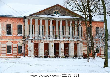 Abandoned manor house of Chaletsky and Voynich-Senkozheskiy in village of Khalch of Vetkovsky district of Gomel region, Belarus. Winter landscape poster