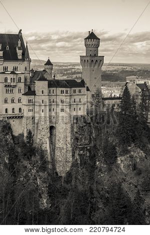 Black and white view of world-famous Neuschwanstein Castle the romantic 19th century Romanesque Revival palace built for King Ludwig II, Bavaria, Germany