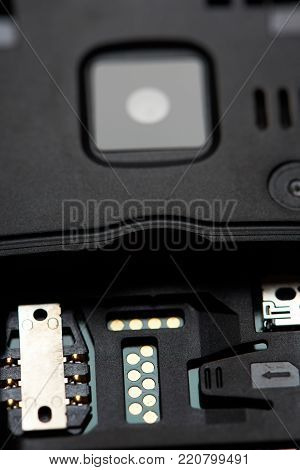 Empty sim card slot in mobile phone close up