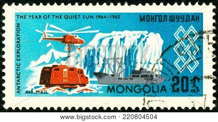 Ukraine - circa 2018: A postage stamp printed in Mongolia shows Helicopter, ship, dwelling, ice and the inscription Antarctic exploration. Series: International Year of the Sun. Circa 1965.