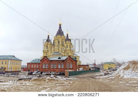 Nizhny Novgorod, Russia. - December 1.2017. The Cathedral of Alexander Nevsky. Due to the construction of a football stadium, many old buildings were demolished next to him.