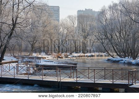 Winter view on the Yauza river and pontoon bridge in Moscow Sviblovo district