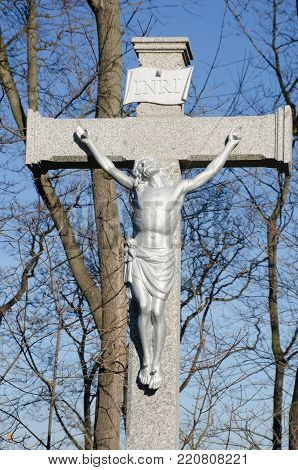Statue of Christ crucified on Stone Cross
