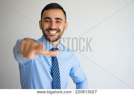 Closeup portrait of joyful office worker laughing and pointing finger at camera. Personnel manager picking professionals for new project. Business and head hunting concept