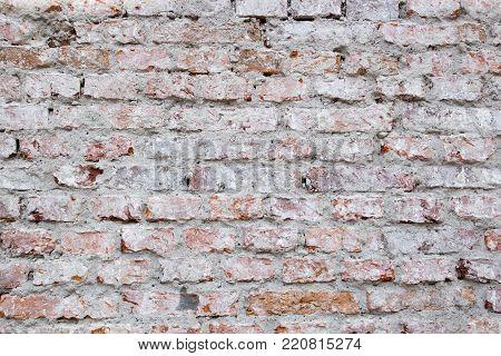 Old broken monotonous brick wall, background, pattern