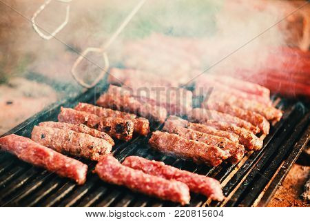 Barbecues and sausages on the grill, details from the picnic.