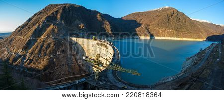 The Enguri Hydroelectric Power Station Hes. The Jvari Reservoir Next To Inguri Dam, Surrounded By Mo