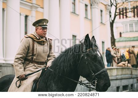 Gomel, Belarus - November 7, 2017: Celebration For The Century Of October Revolution. Reenactor In The Form Of White Guard Soldiers Of Imperial Russian Army Riding Horse.
