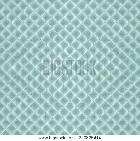 Blue seamless geometric texture of waffles. Waffle symmetrical abstract background with rhombus-honeycomb